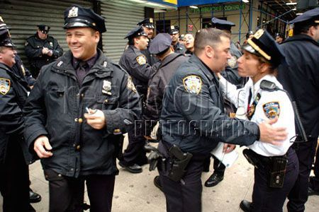 Members of the New York City police department congratulate themselves after a hard days work on the mean streets of New York. USA.