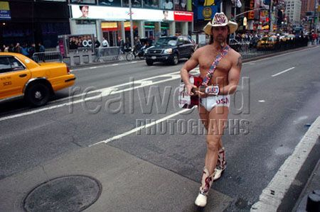 John Robert Burck II � wearing nothing but cowboy boots, a cowboy hat and white briefs reading 'Naked Cowboy' in bold letters on the rear � has taken up residence in the heart of Times Square.