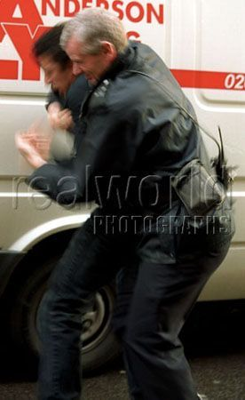 A London Metropolitan police officer wrestles with a man on a Soho street. The man was later charged with assaulting a police officer and sentenced. London, England. Gary Moore photo.